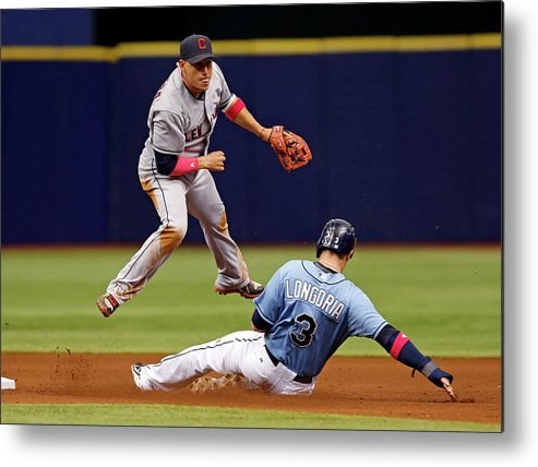 Following Metal Print featuring the photograph Evan Longoria And Asdrubal Cabrera by Mike Carlson