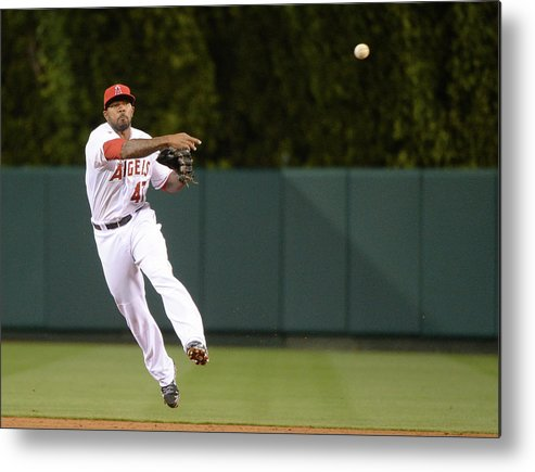 Second Inning Metal Print featuring the photograph Justin Smoak and Howie Kendrick by Harry How