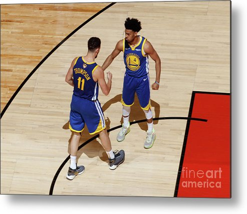 Playoffs Metal Print featuring the photograph Klay Thompson and Jonas Jerebko by Mark Blinch