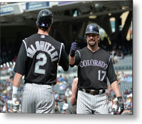 People Metal Print featuring the photograph Todd Helton and Troy Tulowitzki by Denis Poroy