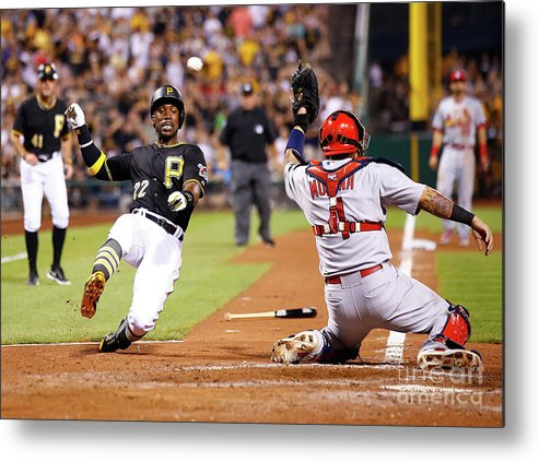 St. Louis Cardinals Metal Print featuring the photograph Yadier Molina and Andrew Mccutchen by Jared Wickerham