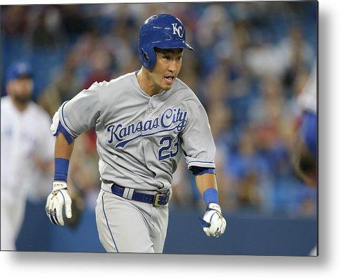 American League Baseball Metal Print featuring the photograph Kansas City Royals V Toronto Blue Jays by Tom Szczerbowski