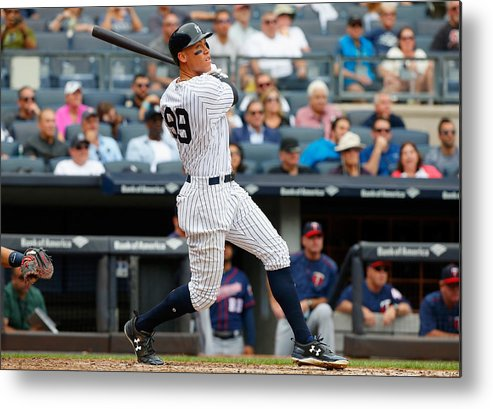 Following Metal Print featuring the photograph Minnesota Twins v New York Yankees by Jim McIsaac