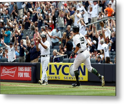 People Metal Print featuring the photograph Oakland Athletics v New York Yankees by Elsa