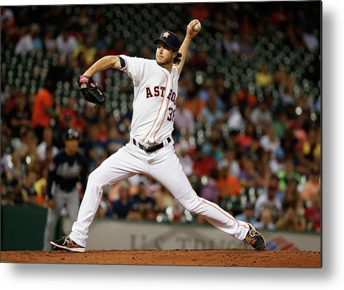 American League Baseball Metal Print featuring the photograph Atlanta Braves V Houston Astros by Scott Halleran