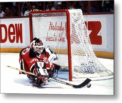 National Hockey League Metal Print featuring the photograph Brodeur stops Flyers by B Bennett