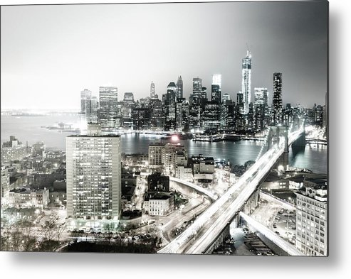 Lower Manhattan Metal Print featuring the photograph New York City Skyline At Night by Mundusimages