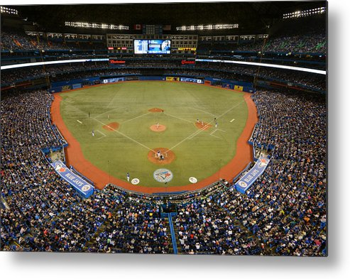 American League Baseball Metal Print featuring the photograph New York Yankees V. Toronto Blue Jays by Mark Cunningham