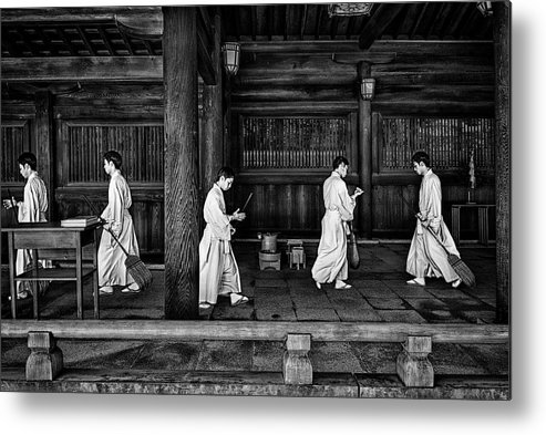 Monk Metal Print featuring the photograph The Going And The Being Back Of A Monk In The Sweeping Of The Temple (tokio) by Joxe Inazio Kuesta