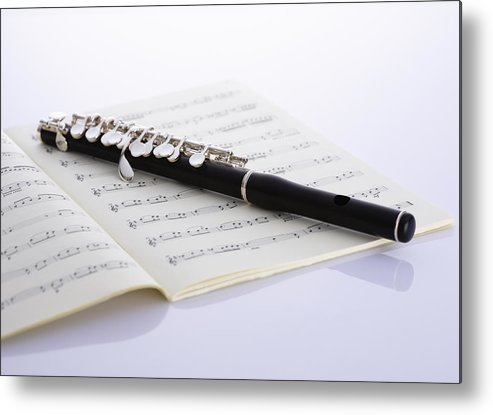 Sheet Music Metal Print featuring the photograph Piccolo On A Score by Imagenavi