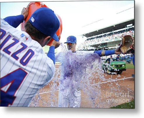 Following Metal Print featuring the photograph St Louis Cardinals V Chicago Cubs by Nuccio Dinuzzo