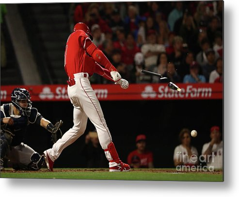 People Metal Print featuring the photograph New York Yankees V Los Angeles Angels by Victor Decolongon