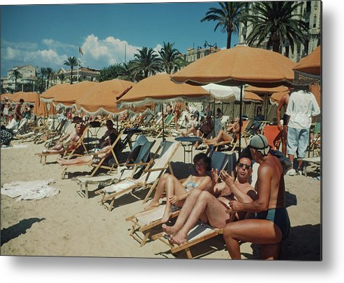 Sunbathing Metal Print featuring the photograph Cannes France by Michael Ochs Archives