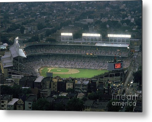 1980-1989 Metal Print featuring the photograph Wrigley Field by Jonathan Daniel