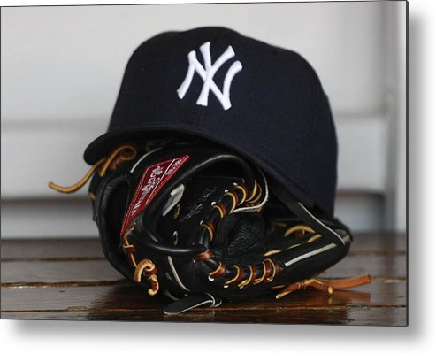 American League Baseball Metal Print featuring the photograph New York Yankees V Florida Marlins by Ronald C. Modra/sports Imagery