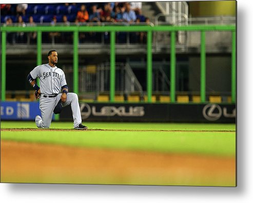 American League Baseball Metal Print featuring the photograph Seattle Mariners V Miami Marlins by Mike Ehrmann