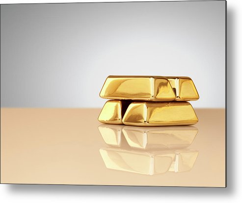 Four Objects Metal Print featuring the photograph A Stack Of Four Gold Ingots by Anthony Bradshaw