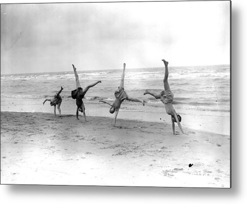 People Metal Print featuring the photograph Cartwheels by Fox Photos