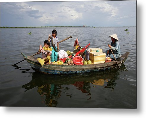 Child Metal Print featuring the photograph Family & Snake Sell Wares On Tonle by Rosemary Calvert