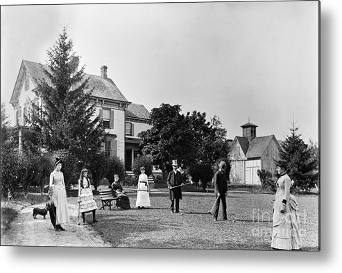 People Metal Print featuring the photograph Family Plays Croquet In Front Of Home by Bettmann