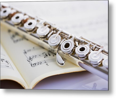 Sheet Music Metal Print featuring the photograph Flute On A Score by Imagenavi