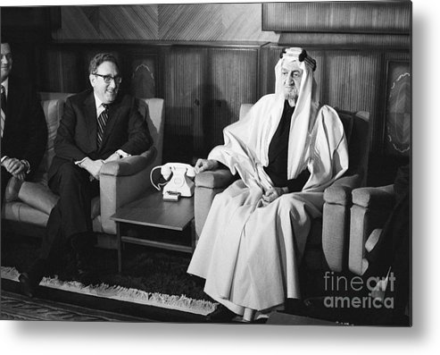 People Metal Print featuring the photograph Henry Kissinger With King Faisal by Bettmann