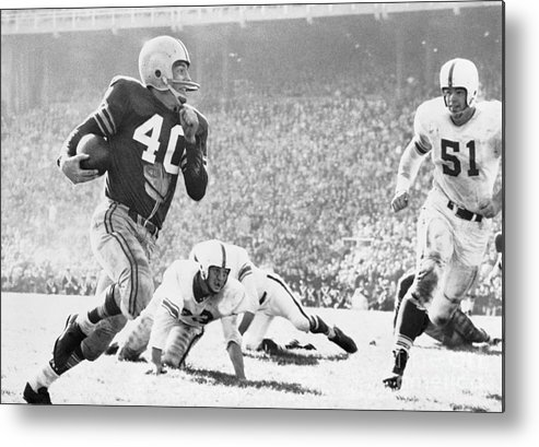 American Football Uniform Metal Print featuring the photograph Howard Cassady Running With Football by Bettmann