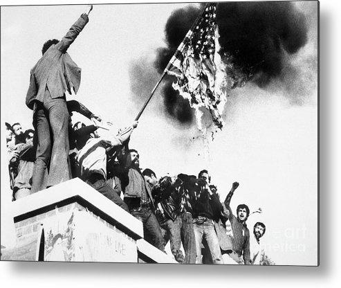 Burnt Metal Print featuring the photograph Iranian Demonstrators Burning American by Bettmann