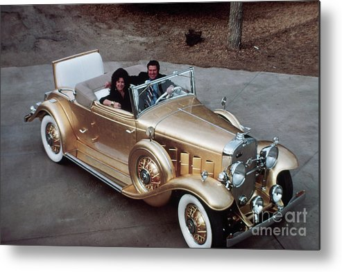 Mid Adult Women Metal Print featuring the photograph Jack Smith In Gold Plated 1931 Cadillac by Bettmann