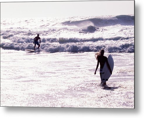 Wind Metal Print featuring the photograph Man Surfing On Sea, Woman Walking With by Johner Images