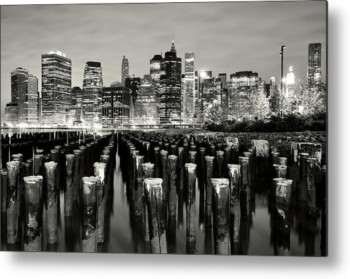 Wooden Post Metal Print featuring the photograph Manhattan At Night by Shobeir Ansari
