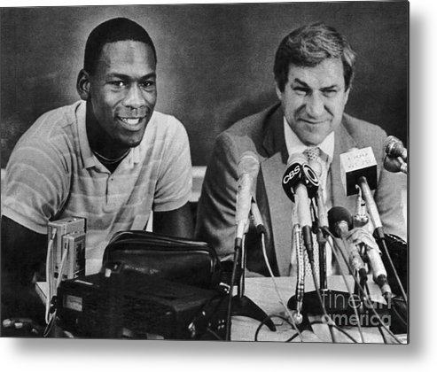 1980-1989 Metal Print featuring the photograph Michael Jordan And Coach Dean Smith by Bettmann