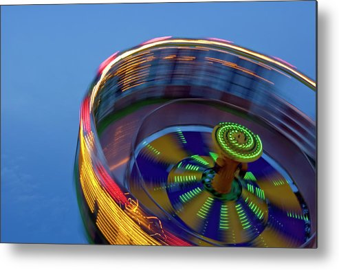 Carousel Metal Print featuring the photograph Multicolored Spinning Carnival Ride by By Ken Ilio