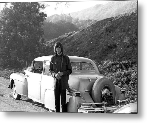 Singer Metal Print featuring the photograph Neil Young And His Classic Car by Michael Ochs Archives
