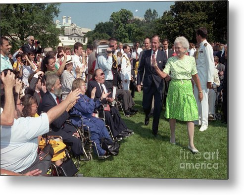 Crowd Of People Metal Print featuring the photograph President George Bush And First Lady by Bettmann