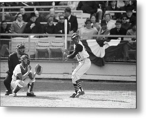 Baseball Catcher Metal Print featuring the photograph Roberto Clemente Batting During Game by Bettmann