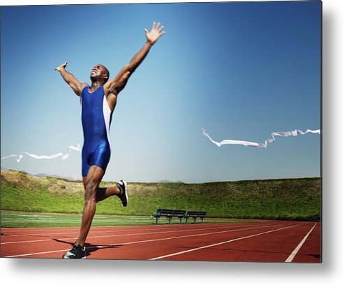Human Arm Metal Print featuring the photograph Runner Crossing Finish Line by Jupiterimages
