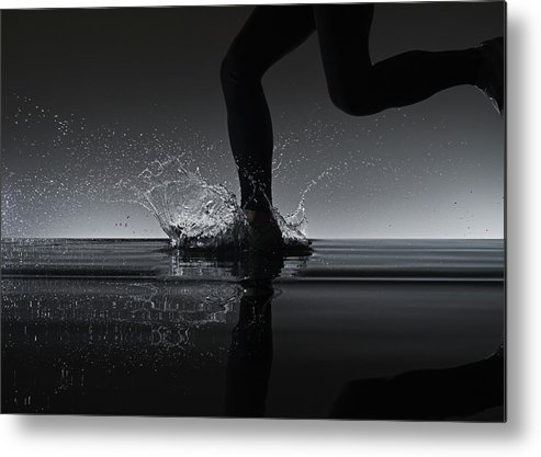 Recreational Pursuit Metal Print featuring the photograph Running Through Water by Jonathan Knowles