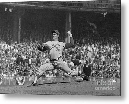 Sandy Koufax Metal Print featuring the photograph Sandy Koufax Pitching In World Series by Bettmann