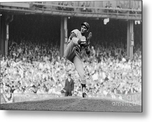 Sandy Koufax Metal Print featuring the photograph Sandy Koufax Throwing Pitch In World by Bettmann