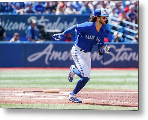 People Metal Print featuring the photograph Seattle Mariners V Toronto Blue Jays by Mark Blinch