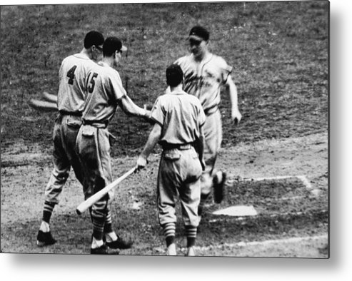 St. Louis Cardinals Metal Print featuring the photograph Whitey Kurowski Comes Home by Hulton Archive