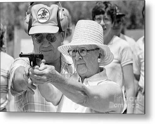 1980-1989 Metal Print featuring the photograph Woman Practicing Firing A Gun by Bettmann