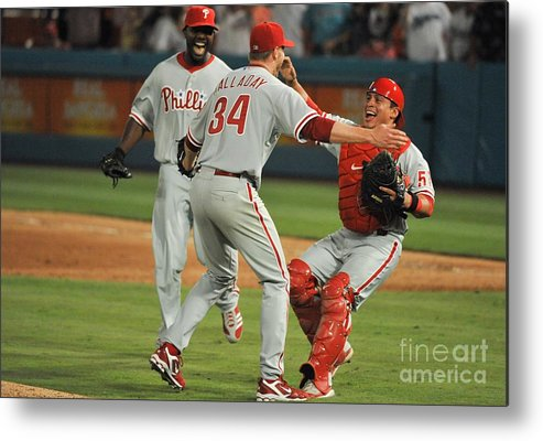 Carlos Ruiz Metal Print featuring the photograph Carlos Ruiz, Ryan Howard, and Roy Halladay by Ronald C. Modra