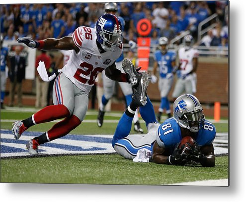 Detroit Metal Print featuring the photograph New York Giants v Detroit Lions by Gregory Shamus