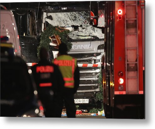 Berlin Metal Print featuring the photograph Lorry Drives Through Christmas Market In Berlin by Sean Gallup