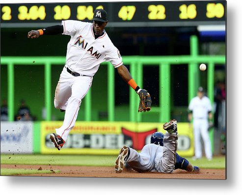 American League Baseball Metal Print featuring the photograph Adeiny Hechavarria And Jean Segura by Alex Trautwig