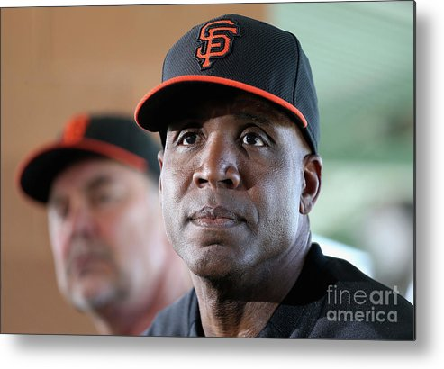 Bruce Bochy Metal Print featuring the photograph Bruce Bochy and Barry Bonds by Christian Petersen