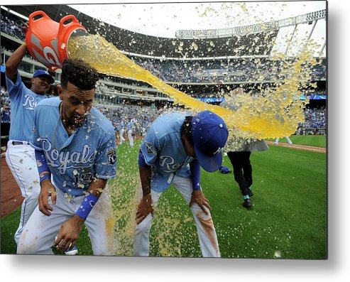 Salvador Perez Diaz Metal Print featuring the photograph Cheslor Cuthbert and Raul Mondesi by Ed Zurga