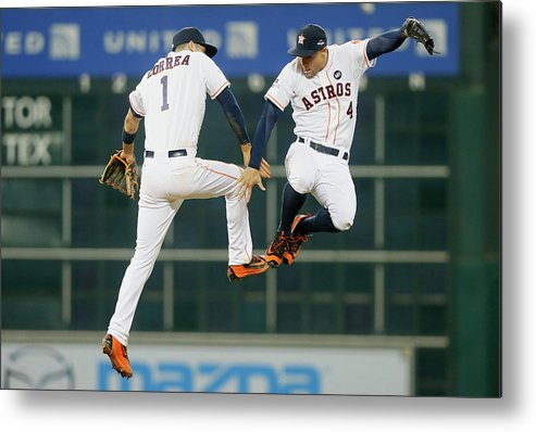 People Metal Print featuring the photograph George Springer and Carlos Correa by Bob Levey